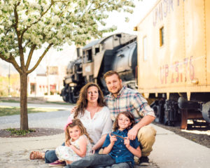 About, Chris Moss, image of a family with a train car in the background