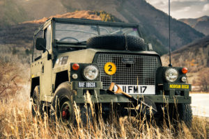 picture of old land rover in a mountain setting