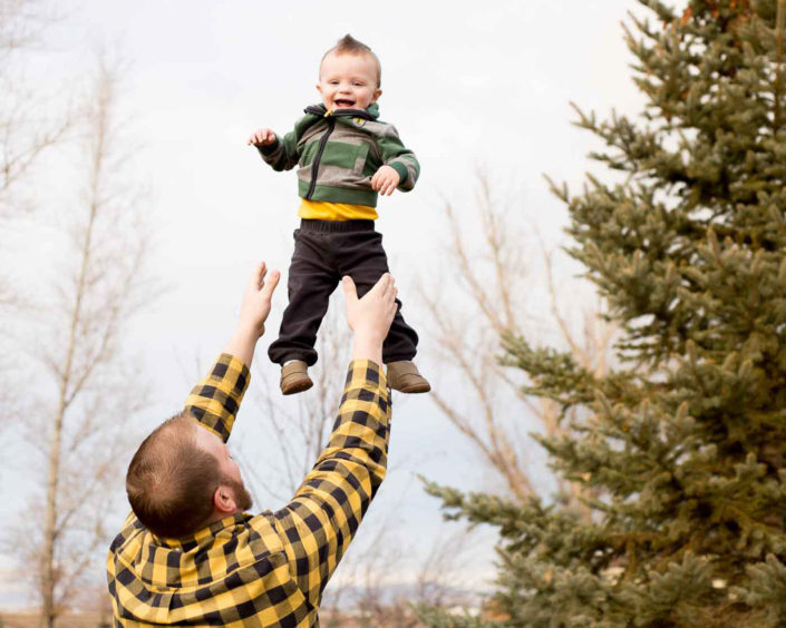 Moss Image, Portrait, Moab Photographer, Dad throwing son in air