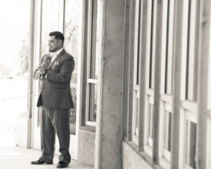 Wedding, Moss Image, Moab Photographer, Portrait, Chris Moss, Portfolio image black and white portrait photo of man in suit with cement wall behind him