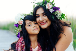 Portrait, Moss Image, Moab Photographer, Girls with purple and pink flowers in their hair smiling