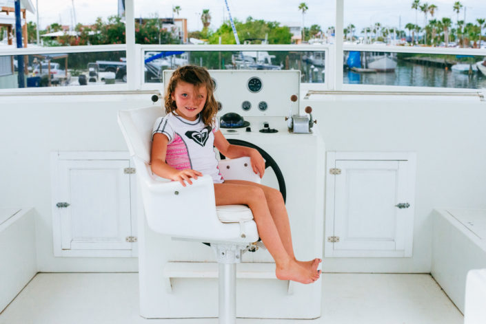 girl in captains chair, moss image, chris moss, moab photographer, cuba, florida