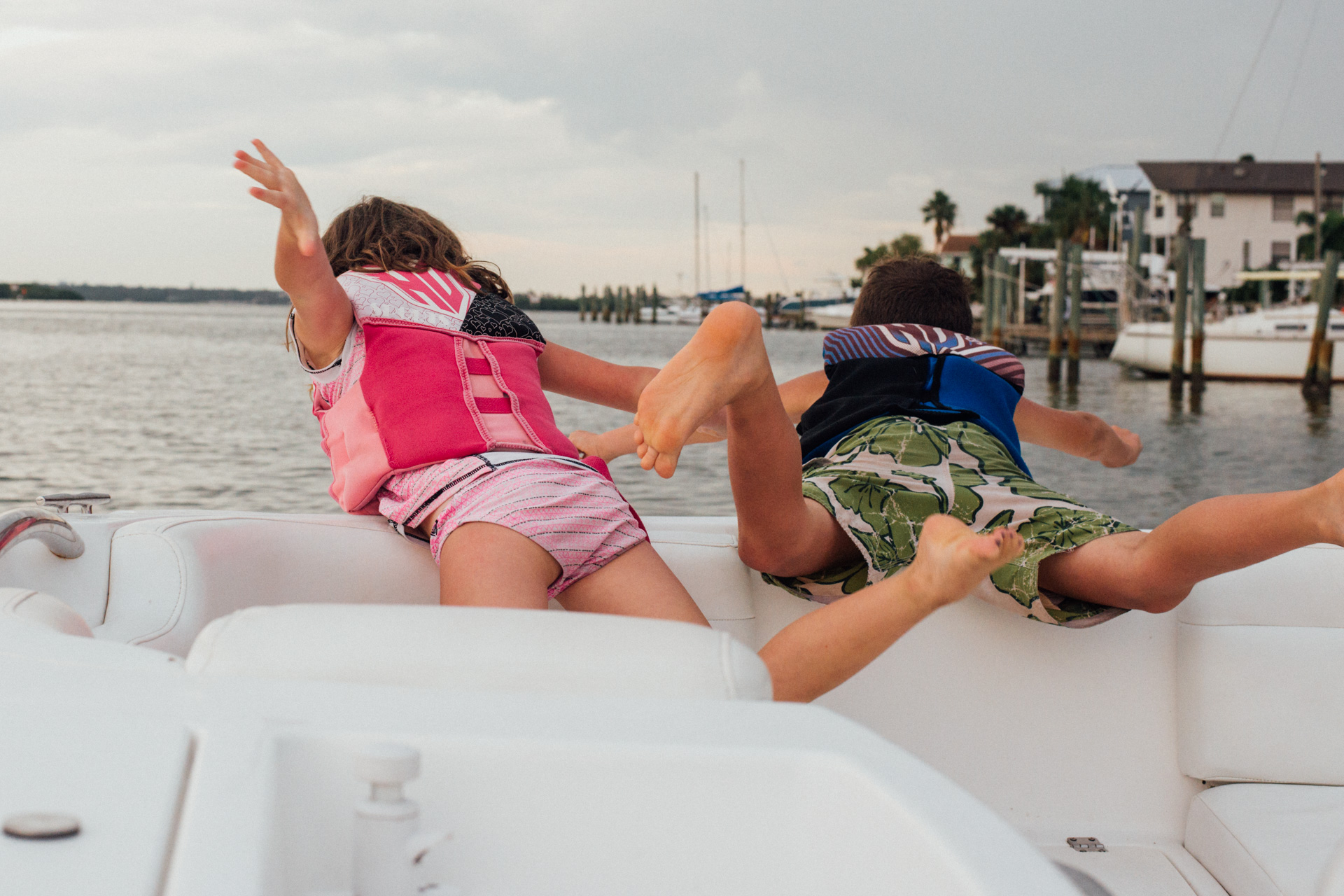 Kids playing on boat - moss image, chris moss, cuba, florida, moab photographer
