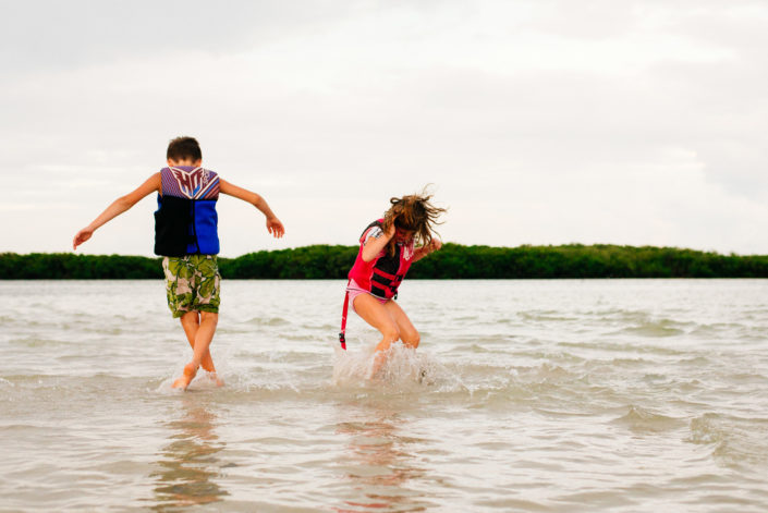 kids playing in water. moss image, cuba, florida, moab photographer