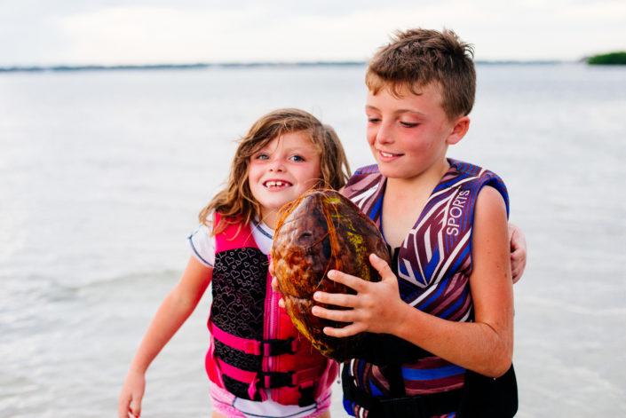 kids with coconut, moss image, cuba, florida, chris moss