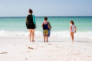 Moss Image, family on beach