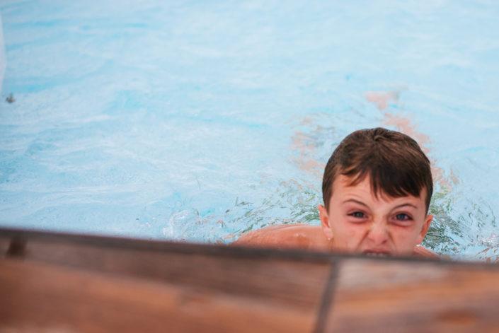 kid playing in pool, cuba, travel