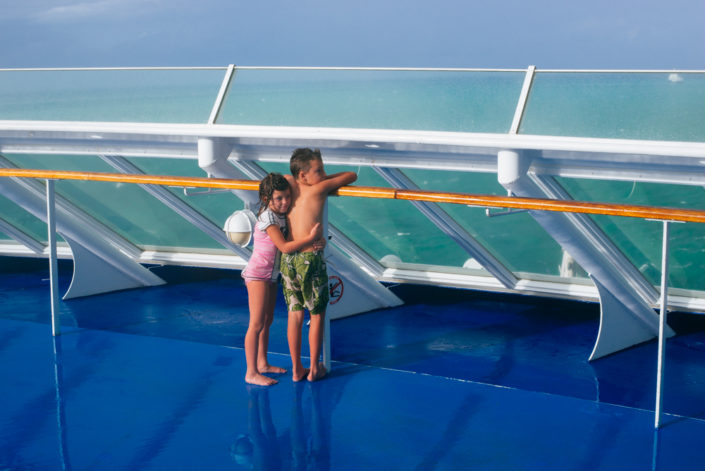 kids standing on bow of ship upper deck, travel, cuba, moss image
