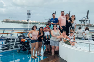 family standing on ship, cuba, travel