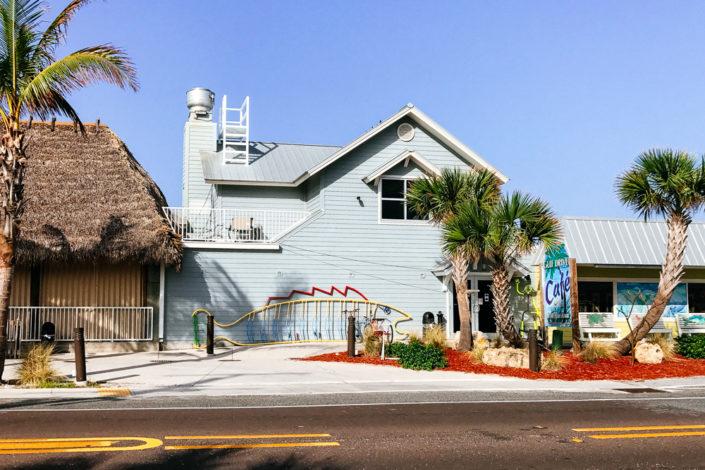 house on beach, restaurant, blue sky, moss image, moab photographer, travel
