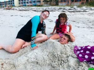 Moss Image, Anna Maria Island, kid in sand shaped like a mermaid.